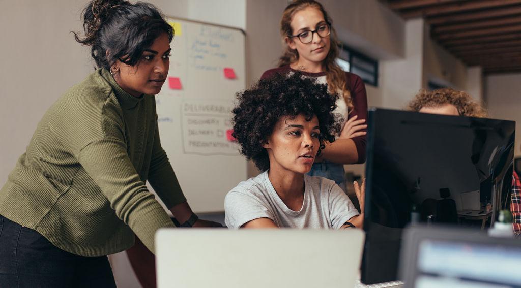 three-people-looking-at-computer-screen