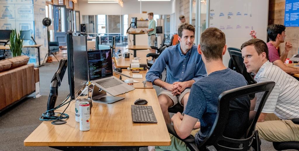 3-mean-talking-at-desk